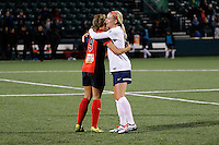 Rochester, NY - Friday April 29, 2016: Western New York Flash forward Lynn Williams (9) hugs Washington Spirit defender Megan Oyster (4) after the match. The Washington Spirit defeated the Western New York Flash 3-0 during a National Women's Soccer League (NWSL) match at Sahlen's Stadium.