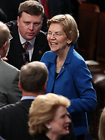 United States Senator Elizabeth Warren (Democrat of Massachusetts) in discussion with her colleagues prior to US President Donald J. Trump delivering his second annual State of the Union Address to a joint session of the US Congress in the US Capitol in Washington, DC on Tuesday, February 5, 2019. Photo Credit: Alex Edelman/CNP/AdMedia