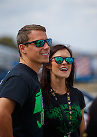 Oct 15, 2016; Ennis, TX, USA; NHRA pro stock driver Alex Laughlin with wife Sierra Laughlin during qualifying for the Fall Nationals at Texas Motorplex. Mandatory Credit: Mark J. Rebilas-USA TODAY Sports