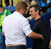 Fleetwood Town Manager Joey Barton shares a joke with Oxford United Manager Karl Robinson before kick off<br /> <br /> Photographer David Shipman/CameraSport<br /> <br /> The EFL Sky Bet League One - Oxford United v Fleetwood Town - Saturday August 11th 2018 - Kassam Stadium - Oxford<br /> <br /> World Copyright &copy; 2018 CameraSport. All rights reserved. 43 Linden Ave. Countesthorpe. Leicester. England. LE8 5PG - Tel: +44 (0) 116 277 4147 - admin@camerasport.com - www.camerasport.com