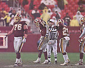 Washington Redskins quarterback Tony Banks (12) walks off the field after being injured in fourth quarter action of the game against the Arizona Cardinals on January 6, 2002.  Pictured with him are offensive tackle Jon Jansen (76) and running back Ki-Jana Carter (23).  The Redskins won the game 20 - 17.<br /> Credit: Arnie Sachs / CNP