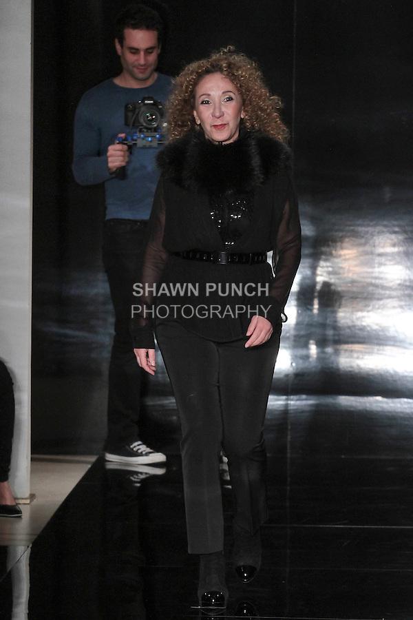 Fashion designer Reem Acra walks runway for the close of her Reem Acra Spring 2017 bridal collection fashion show, during New York Bridal Fashion Week Spring Summer 2017, on April 15, 2016.