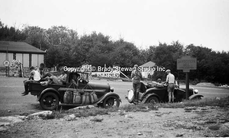 Harrisonville PA:  County Workers driving a 1929 Chevrolet International Sport Cabriolet and a 1931 Chevrolet 1/2 ton truck breaking for lunch on Sideling Hill Summit.  This section of the Lincoln Highway, Route 30 has an elevation of 2195 feet - 1931