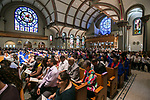 Friends and family join the graduates as they gather for the annual Baccalaureate Mass at the Saint Vincent de Paul Parish Church on DePaul University's Lincoln Park Campus Friday, June 9, 2017. The event was part of the 119th commencement ceremonies for the Chicago university. (DePaul University/Jamie Moncrief)