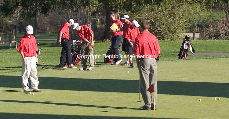 SOUTHBURY, CT - 03 MAY 2007 - 050307JW08.jpg -- Pomperaug golf team gets some putting practice Thursday afternoon at Heritage Village Golf course after Pomperaug defeated Bethel 150-215. Jonathan Wilcox Republican-American