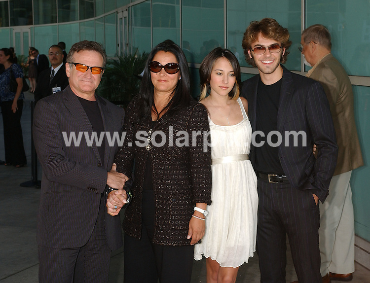 **ALL ROUND PICTURES FROM SOLARPIX.COM**.**WORLDWIDE SYNDICATION RIGHTS EXCLUDING - FRANCE** .The premiere of the film Licence to Wed in Hollywood California in the USA at the Arclight Theater held on the 25_06_07..This pic:Robin Williams with wife, daughter, and daughter's boyfriend.JOB REF: 4134-GLS       DATE:25_06_07.**MUST CREDIT SOLARPIX.COM OR DOUBLE FEE WILL BE CHARGED* *UNDER NO CIRCUMSTANCES IS THIS IMAGE TO BE REPRODUCED FOR ANY ONLINE EDITION WITHOUT PRIOR PERMISSION*