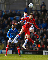 Scott Wagstaff of Gillingham and Dion Donohue of Portsmouth vie for a header during Portsmouth vs Gillingham, Sky Bet EFL League 1 Football at Fratton Park on 10th March 2018