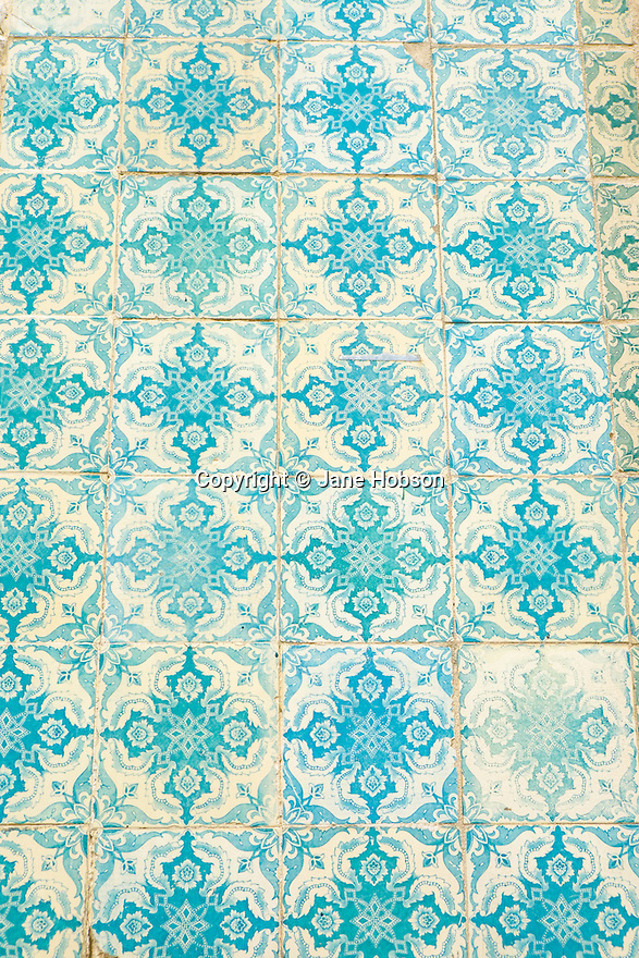 Lisbon, Portugal. 21.03.2015. Hand-painted tiles on the external walls of builings in the Alfama district of Lisbon. © Jane Hobson.