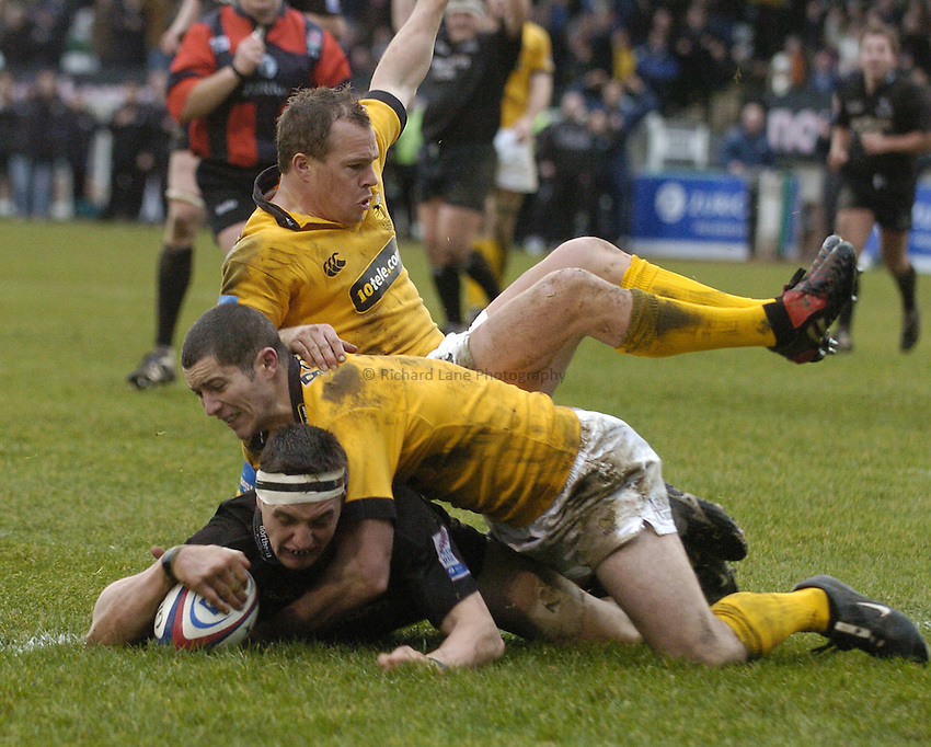 Photo. Jed Wee..Newcastle Falcons v London Wasps, Zurich Premiership, 06/02/2005..Newcastle's Phil Dowson scores a try, with Michael Roberts (middle) and Mark van Gisbergen.