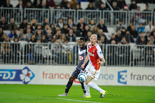 16.12.2015. Bordeaux, France. French League cup football from the Stade Chaban-Delmas. Bordeaux versus Monaco.  Andre Poko (gir) sees his cross deflected by Andrea Raggi (asm)
