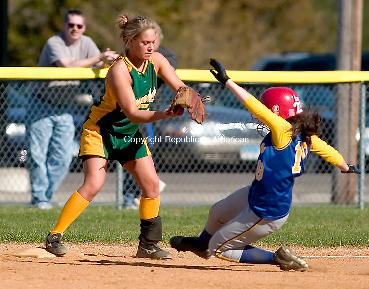 SEYMOUR, CT- 20 APRIL 07- 042007JT03- <br /> Holy Cross' Gretchen Tholen makes an out at third base as Seymour's Katie Barsevich slides towards her during Friday's game at Seymour. Seymour won 6-3.<br /> Josalee Thrift Republican-American
