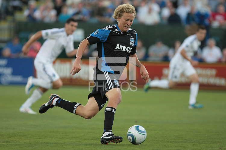 Steven Lenhart runs the the ball down the field. The San Jose Earthquakes tied the Vancouver Whitecaps 2-2 at Buck Shaw Stadium in Santa Clara, California on July 20th, 2011.