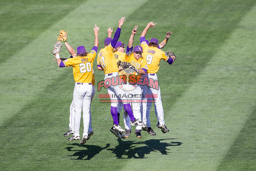 LSU Tigers celebrate beating Cal State Fullerton in the NCAA College baseball World Series on June 16, 2015 at TD Ameritrade Park in Omaha, Nebraska. LSU defeated Fullerton 5-3. (Andrew Woolley/Four Seam Images)