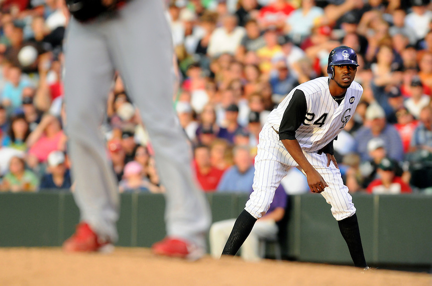06 JULY 2010: Colorado Rockies center fielder Dexter Fowler (24) keeps his eye on the starting pitcher as he leads off of first base during a regular season Major League Baseball game between the Colorado Rockies and the St. Louis Cardinals at Coors Field in Denver, Colorado. The Rockies beat the Cardinals 12-9 after a 9 run 9th inning.  *****For Editorial Use Only*****