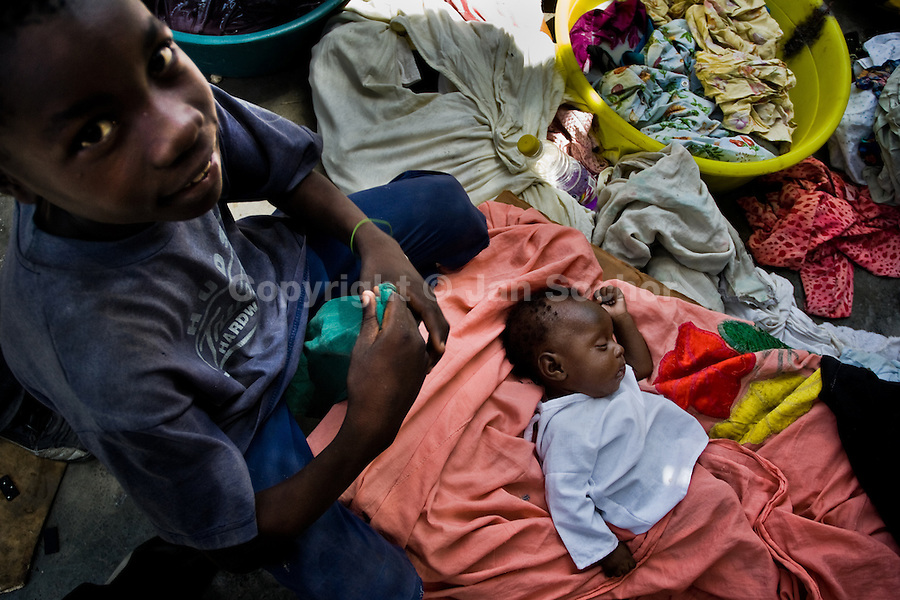 A Haitian baby sleeps in a blanket in the slum of Cité Soleil, Port-au-Prince, Haiti, 24 July 2008. Cité Soleil is considered one of the worst slums in the Americas, most of its 300.000 residents live in extreme poverty. Children and single mothers predominate in the population. Social and living conditions in the slum are a human tragedy. There is no running water, no sewers and no electricity. Public services virtually do not exist - there are no stores, no hospitals or schools, no urban infrastructure. In spite of this fact, a rent must be payed even in all shacks made from rusty metal sheets. Infectious diseases are widely spread as garbage disposal does not exist in Cité Soleil. Violence is common, armed gangs operate throughout the slum.