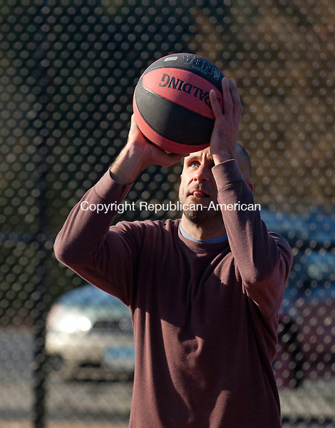 SOUTHBURY, CT-31 December 2013-123113BF02- Thomas Moccaie from Oxford shoots some hoops at the basketball courts at Community Park on Community House Road in Southbury Tuesday afternoon. Moccaie said he was talking advantage of the sunny day because the bad weather expected in the next couple of days. The former high school basketball player said he plays once or twice a week even in the winter and when it's cold outside and has been playing basketball since he was a little kid.    Bob Falcetti Republican-American