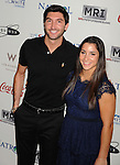 LOS ANGELES {CA} - JANUARY 12: Evan Lysacek and Aly Raisman attend the Gold Meets Gold Event, held at the Equinox Sports Club Flagship West Los Angeles location on Saturday, January 12, 2013 in Los Angeles, California.