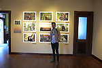 National Geographic Young Explorer Eddie Roqueta stands in front of his photographs documenting sun bears in Indonesia and Malaysia on exhibit at the Aa Haa West Gallery during the Mountainfilm Festival in Telluride, Colorado on May 22, 2015.