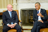 United States President Barack Obama meets retired NASA astronaut Scott Kelly in the Oval Office of the White House in Washington, DC on Friday, October 21, 2016.<br /> Credit: Ron Sachs / Pool via CNP