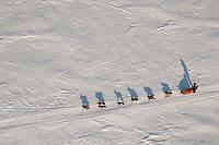 Monday March 15   Lance Mackey runs on Golovin Bay on his way toward White Mountain