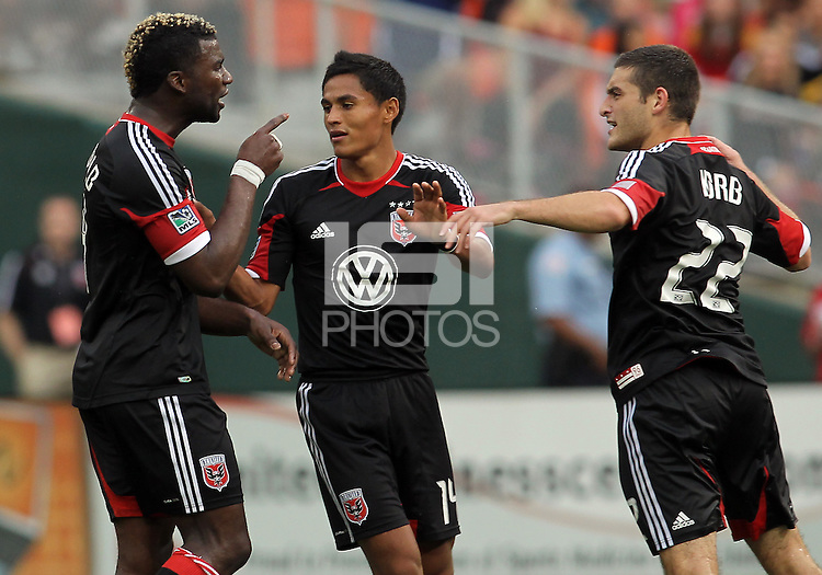 WASHINGTON, D.C. - AUGUST 19, 2012:  Andy Najar (14) of DC United tries to stop an argument between Brandon McDonald (4) and Chris Kolb (22) at the end of an MLS match against the Philadelphia Union at RFK Stadium, in Washington DC, on August 19. The game ended in a 1-1 tie.