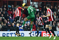 Preston's Callum Robinson beats Brentford's Andreas Bjelland to the ball <br /> <br /> Photographer Jonathan Hobley/CameraSport<br /> <br /> The EFL Sky Bet Championship - Brentford v Preston North End - Saturday 10th February 2018 - Griffin Park - Brentford<br /> <br /> World Copyright &copy; 2018 CameraSport. All rights reserved. 43 Linden Ave. Countesthorpe. Leicester. England. LE8 5PG - Tel: +44 (0) 116 277 4147 - admin@camerasport.com - www.camerasport.com