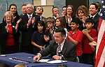 A crowd of lawmakers and fifth-graders applaud after Gov. Brian Sandoval signs the school bond bill into law at a local elementary school in Carson City, Nev., on Wednesday, March 4, 2015. The bill, which received bipartisan support in both houses, will result in new school construction in Las Vegas beginning in the next few months. <br /> Photo by Cathleen Allison