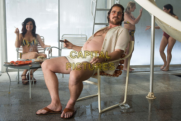 Christian Bale<br /> in American Hustle (2013) <br /> *Filmstill - Editorial Use Only*<br /> CAP/NFS<br /> Image supplied by Capital Pictures
