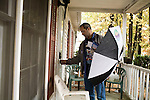 November 4, 2008. Durham, NC.. Peter Armenia, a Obama volunteer, knocks on a door of a registered voter. After knocking on 6 or 7 doors, Armenia found no voters in the predominantly African American neighborhood who had not voted.. The Obama campaign had teams of volunteers going out, door to door, to make sure every last voter had got the polls.