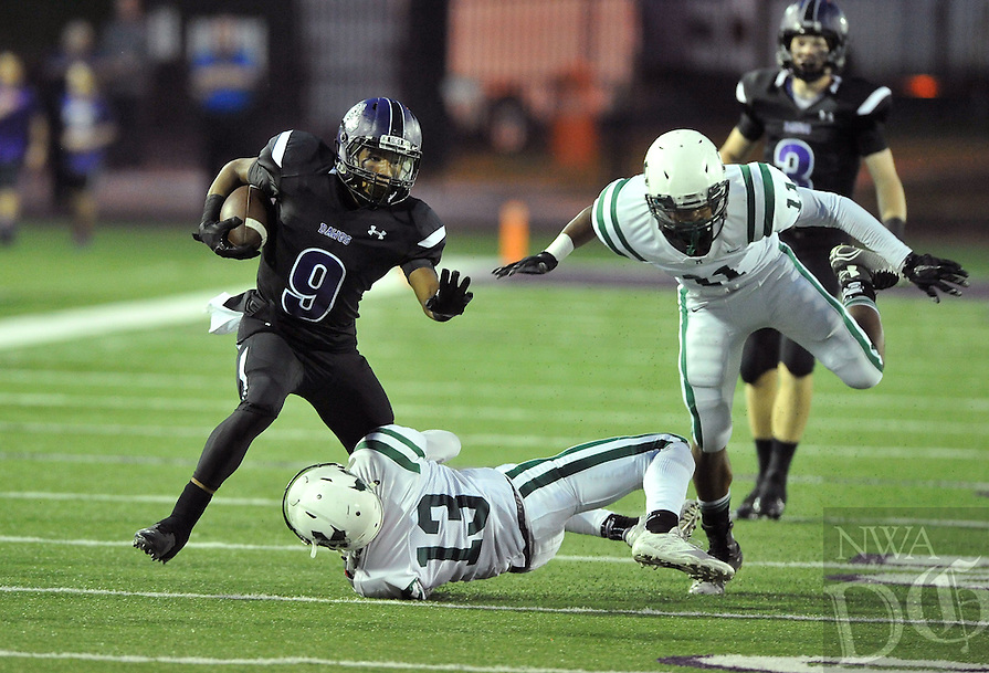 NWA Democrat-Gazette/MICHAEL WOODS &bull; @NWAMICHAELW<br /> Fayetteville High School receiver Terrance Rock (9) tries to shake Muskogee defenders Tavian Davis (13) and Devon McCoy (11) during the first half of the Bulldogs game Friday September 18, 2015 in Fayetteville.
