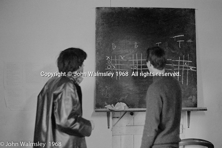 Science tacher and an older kid playing nought & crosses, Summerhill school, Leiston, Suffolk, UK. 1968.