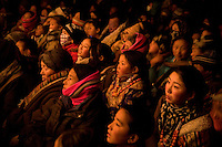 Tibetan pilgrims gather to watch a theatrical performance of traditional Tibetan stories in Xiahe, Gansu, China, during the Monlam Festival.  The city is home to the Labrang Monastery, an important site in Tibetan Buddhism.