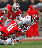 Ohio State Buckeyes defensive back Vonn Bell (11) takes down Indiana Hoosiers wide receiver Shane Wynn (1) with help from Ohio State Buckeyes cornerback Bradley Roby (1) at Ohio Stadium in Columbus, Ohio on November 23, 2013.  (Chris Russell/Dispatch Photo)