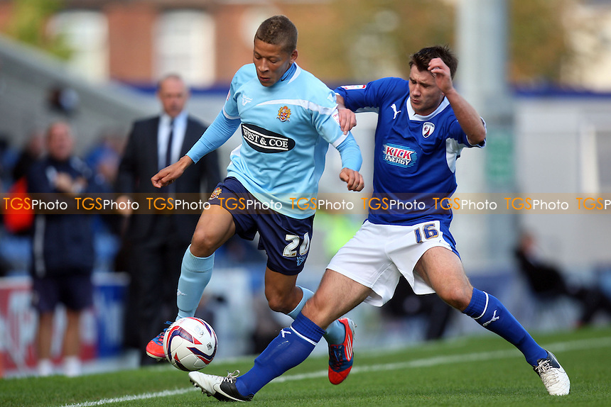 Dwight Gayle of Dagenham and Liam Ridehalgh of Chesterfield - Chesterfield vs Dagenham and Redbridge at the B2Net  Stadium  - 13/10/12 - MANDATORY CREDIT: Dave Simpson/TGSPHOTO - Self billing applies where appropriate - 0845 094 6026 - contact@tgsphoto.co.uk - NO UNPAID USE.