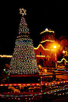 CHRISTMAS LIGHTS ADOURN THE PLAZA NEXT TO THE MISION NUESTRA SENORA DE LORETO IN LORETO, MEXICO