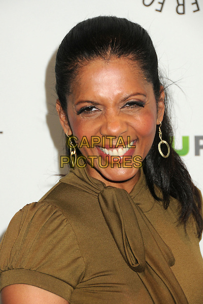 "Penny Johnson Jerald.PaleyFest 2012 Presents ""Castle"" held at The Saban Theatre, Beverly Hills, California, USA, 9th March 2012..portrait headshot earrings dangly  green dress  olive khaki  gold smiling .CAP/ADM/BP.©Byron Purvis/AdMedia/Capital Pictures."