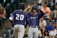 Binghamton Rumble Ponies Andres Gimenez (right) congratulates Ali Sanchez (20) after a home run during an Eastern League game against the Richmond Flying Squirrels on May 29, 2019 at The Diamond in Richmond, Virginia.  Binghamton defeated Richmond 9-5 in ten innings.  (Mike Janes/Four Seam Images)