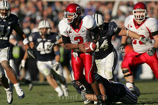 Provo - Brigham Young defensive lineman Ian Dulan (77) wraps up Utah quarterback Brian Johnson (3) on Utah's last drive. Johnson threw the ball away, out of bounds. BYU defeats the University of Utah 17-10 in college football action Saturday at BYU's Lavell Edward Stadium.