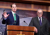 United States Senate Minority Leader Chuck Schumer (Democrat of New York), right, and US Senator Ron Wyden (Democrat of Oregon), the ranking member of the US Senate Finance Committee, left, meet reporters in the US Capitol in Washington, DC to denounce the new tax plan announced by US President Donald J. Trump and House and Senate Republicans as tax cuts for the wealthy on Wednesday, September 27, 2017. PhotoCredit: Ron Sachs/CNP/AdMedia