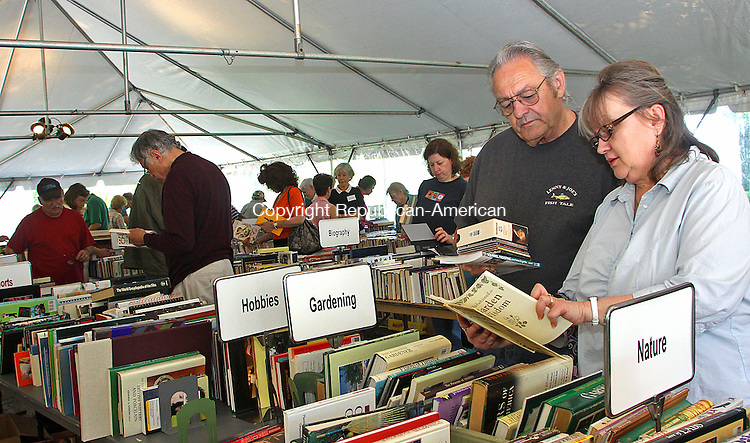 SOUTHBURY CT.-21 MAY 2010-052110DA11- Joe Hanggi and his wife Barbara of Middlebury look over books at the annual Heritage Village Library book sale in Heritage Village Friday. This is a fundraiser for with all profits going to the library.  The sale continues today under a big tent in the in Paddock Parking Lot on the corner of Heritage Rd. and Hilltop Dr. in Heritage Village from 9:30 a.m. to 5 p.m. and Sunday from 10 a.m. to 3 p.m.<br /> Republican-American  Darlene Douty