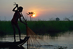 See Kim Lang, 15, pulls in a fishing net at dawn in the village of Phar Thruey in northern Cambodia.