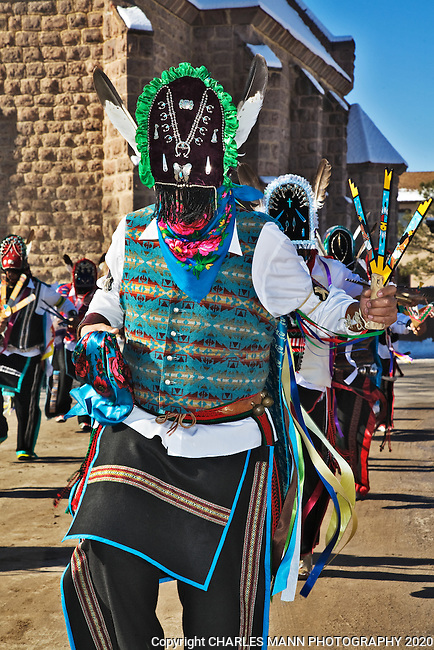 Mysterious Matachine dancers participate in the Christmas Day ceremonies at San Juan Pueblo which is also known as Ohkay Owingeh and is located near the town of  Espanola, NM.