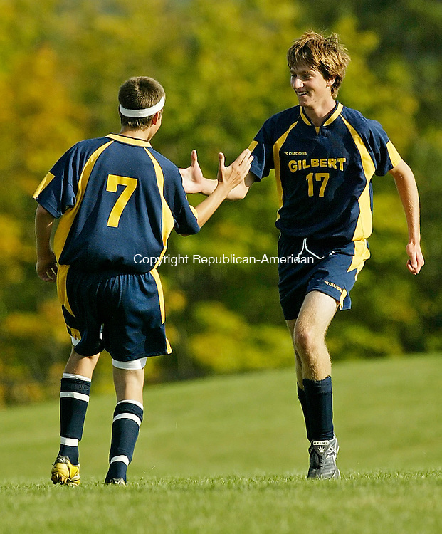 LITCHFIELD, CT, 09/22/08- 092208BZ12- Gilbert's  Devon Kulinski (7) congratulates Alex Brochu (17) on his goal against Litchfield Monday afternoon. <br /> Jamison C. Bazinet Republican-American