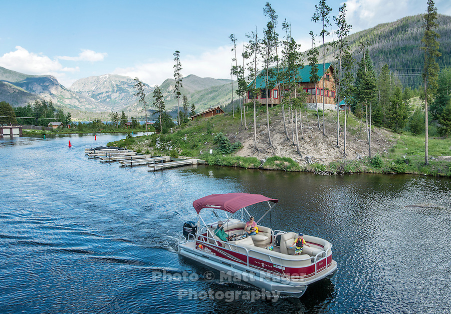 Visitors enjoy an evening on a boat at Grand Lake, Colorado, Monday, June 30, 2015. <br /> <br /> Photo by Matt Nager