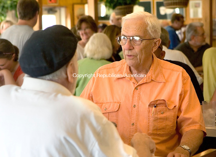 WOODBURY, CT--04 JULY 2006 -070406JS14-Bud Phillips, owner of Phillips Diner in Woodbury, talks with customers during his last day of ownership of the diner on Tuesday. -- Jim Shannon Republican-American