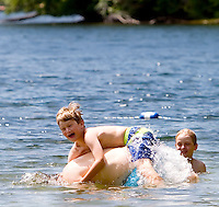 NORFOLK, CT- 30 JUNE 2007- 063007JT06-.Davis Holzman, 8, rides on his father Rick's back as his brother Will, 7, looks on at Toby Pond in Norfolk on Saturday, June 30, 2007..Josalee Thrift Republican-American