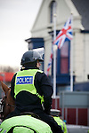 "A mounted police officer on patrol in a street outside Fratton Park stadium before Portsmouth take on local rivals Southampton in a Championship fixture. Around 3000 away fans were taken directly to the game in a fleet of buses in a police operation known as the ""coach bubble"" to avoid the possibility of disorder between rival fans. The match ended in a one-all draw watched by a near capacity crowd of 19,879."