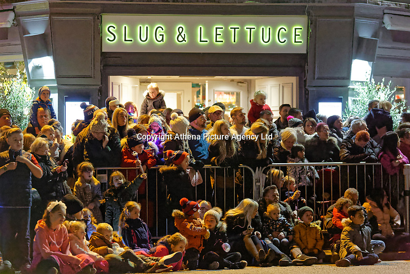 "Pictured: Locals gather at Castle Street to watch the Christmas parade in Swansea, Wales, UK. Sunday 19 November 2018<br /> Re: Swansea Christmas parade attended by thousands has been branded a ""shambles"" for having just three floats.<br /> The annual festive event in south Wales, which took place on Sunday, promised ""dynamic dance-troupes"" as well as ""spectacular shows and stages"".<br /> But the parade was scaled down, leading to a barrage of criticism on social media because of roadworks in the city centre. <br /> The leader of Swansea Council, Rob Stewart apologised on Facebook and said the parade was not ""good enough"".<br /> Parents took on social media to voice their anger, calling the event ""a load of rubbish"" and claiming there was nothing for young children apart from ""a loud music float with Santa on""."