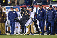 PHILADELPHIA, PA - DEC 8, 2018: Army Black Knights defensive back Elijah Riley (23) makes a crushing tackle on Navy Midshipmen quarterback Garret Lewis (7) late in the fourth quarter of game between Army and Navy at Lincoln Financial Field in Philadelphia, PA. Army defeated Navy 17-10 to win the Commander in Chief Cup. (Photo by Phil Peters/Media Images International)