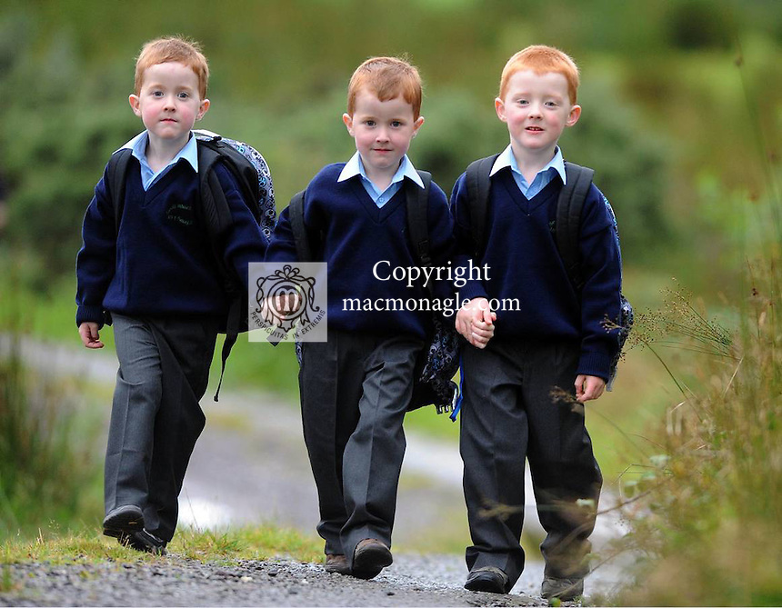 29-08-2012:  Pictured from left are Triplets  Padraig, Sean and  Micheal  Casey  leaving home at  Bohocogram, Sneem, Co. Kerry for their first day at school at St.  Michael's National School Sneem on Wednesday morning.  Picture: Eamonn Keogh (MacMonagle, Killarney)